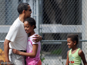 The Obama family (above: the president-elect with daughters Malia and Sasha) will have a quiet New Year's celebration as their vacation draws to a close.