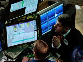 A trader watches the market moves on the floor of the New York Stock Exchange on Monday.