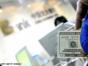 A customer exchanges U.S. dollar notes at a bank in Beijing, China, on Tuesday.
