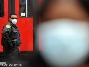 A transport security officer looks on near the U.S.-Mexico border in San Ysidro, California, on Monday.
