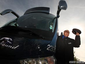 Driver Leon Batchelor helps unveil the first Greyhound coach to operate in the UK.