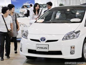 Car buyers at a Toyota showroom in Tokyo.