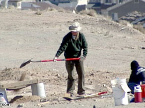 An Albuquerque, New Mexico, police forensics team member digs two weeks ago at the burial site.