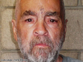 A new photo of Charles Manson shows his gray beard and the swastika tattooed into his forehead.