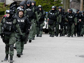 Law enforcement from several jurisdictions respond to a shooting standoff at Pittsburgh home Saturday.
