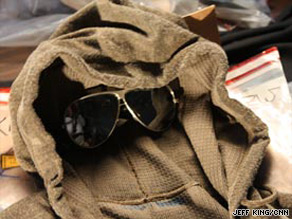 Ted Kaczynski is fighting auction of possessions like this jacket and sunglasses made famous by a police sketch.