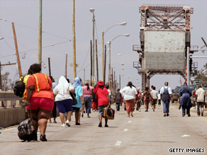 Katrina evacuees cross the Industrial Canal.