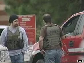 Police officers in body armor vests are on the scene after violence at a school near Myrtle Beach, South Carolina.