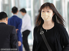 The sight of people wearing masks became common in Hong Kong after the SARS outbreak of 2003.