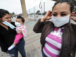 The WHO says face masks are useful primarily for people already ill to stop the virus' spread.