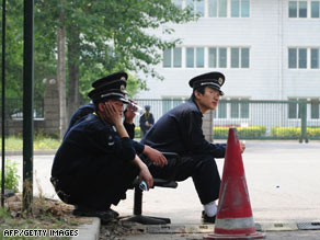 Security guards outside a sealed-off hotel in Beijing on Monday, where Mexican nationals were quarantined.