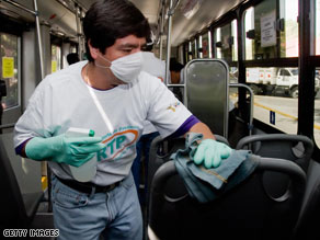 A worker disinfects one of the metrobuses in Mexico City on Tuesday.
