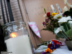 Flowers sit outside the New York school where assistant principal Mitchell Wiener worked.