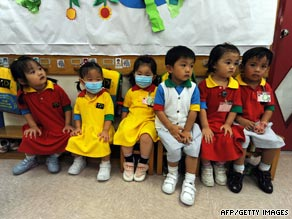 Kindergarten students, some wearing masks, at school in a residential estate in Hong Kong Thursday.