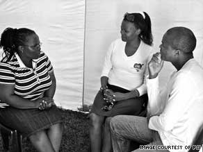 A couple discusses the love test with a PSI member. Before the campaign, only 2 percent of couples got tested.