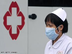 A nurse wears a mask at Sichuan Provincial People's Hospital in Chengdu, China, on Monday.