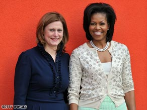 Sarah Brown, left, wears a dress from an American designer. Michelle Obama wears J.Crew.