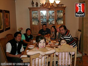 Some members of the Frankel household gather around the dinner table at their home in New Mexico.