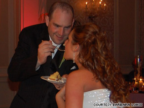 Brian Lohse feeds his wife, Alana, cake at their wedding in June.