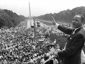 Martin Luther King Jr. waves to supporters from the steps of the Lincoln Memorial on August 28, 1963.