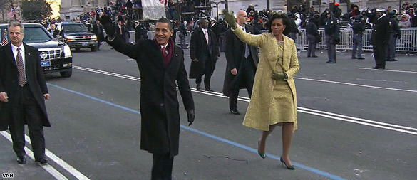 Cheers greet Obamas on parade route