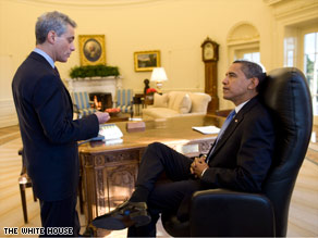 White House Chief of Staff Rahm Emanuel briefs President Obama in the Oval Office.