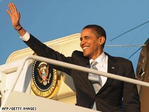 President Obama waves as he boards Air Force One for Chicago, where the Obamas were to spend the weekend.