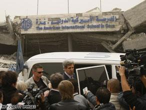 Sen. John Kerry, center, visits the American International School, destroyed by the Israeli attacks on Gaza.