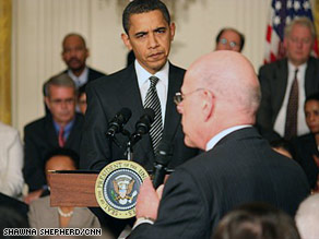 President Obama listens to Rep. Henry Waxman during a Q&A session with those at the summit.