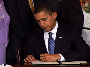 President Obama signs the executive order on stem cell policy Monday at the White House.