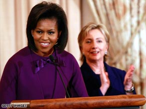 Michelle Obama and Hillary Clinton present the State Department Women of Courage Awards.