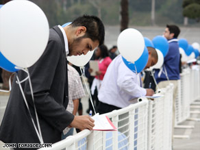 Job seekers in Los Angeles, California, fill out paperwork Saturday at a job fair that attracted 10,000 people.