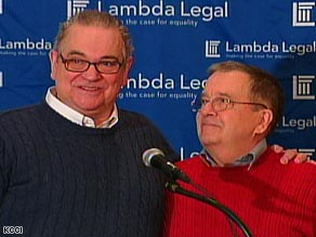 Larry Hoch, left, and David Twombley, one of six couples that filed suit, celebrate Friday at a news conference.
