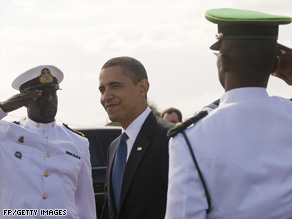 President Obama is saluted as he arrives Friday in Trinidad for the Summit of the Americas.
