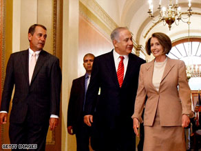 Israeli Prime Minister Benjamin Netanyahu walks Tuesday with Reps. John Boehner, left, and Nancy Pelosi.