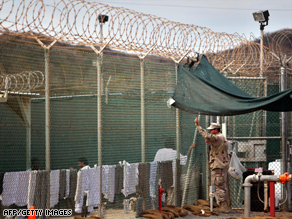 A guard talks with a detainee at Guantanamo Bay, Cuba, earlier this year.