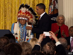 Joe Medicine Crow-High Bird, the last living Plains Indian war chief, receives his medal from President Obama.