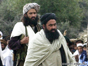 Baitullah Mehsud, right, and a bodyguard arrive at a meeting in South Waziristan, Pakistan, in 2004.
