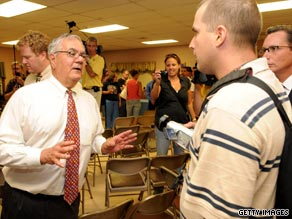 Rep. Barney Frank argues with a man after a town hall meeting Tuesday night in Dartmouth, Massachusetts.