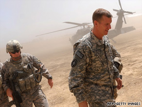 Gen. Stanley McChrystal, right, arrives at a U.S. base in Logar Province, Afghanistan, last month.