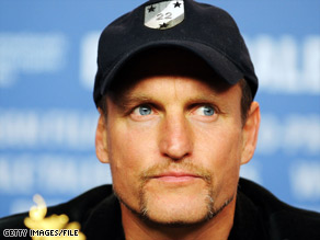 Woody Harrelson says he got into a clash with a photographer because he mistook him for a zombie.