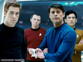 The crew of the Enterprise, led by James Kirk (Chris Pine, left) goes forth on a new voyage.