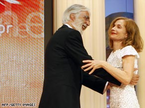 Austrian director Michael Haneke hugs the president of the Cannes jury, French actress Isabelle Huppert.