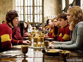 Ron (Rupert Grint, left), Harry (Daniel Radcliffe, second from right) and Hermione (Emma Watson) in the new film.