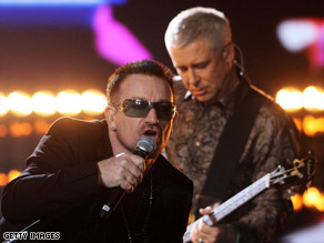 Bono, left,  and Adam Clayton perform at a recent awards show. U2 has been together for 30 years.