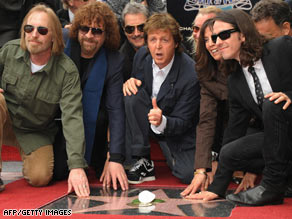 From left, musicians Tom Petty, Jeff Lynne and Paul McCartney join Harrison's relatives for dedication of his star.