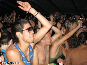 Festival attendees enjoy the music Saturday, Day Two of the Coachella music festival in Indio, California.