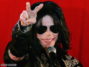 Michael Jackson gestures to the crowd at the March announcement for his series of London concerts.