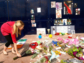 Fans started laying tributes to Michael Jackson at a temporary shrine at the O2 Arena the day after his death.