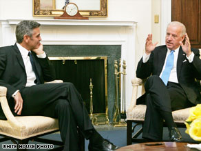 George Clooney, left, talks with Vice President Joe Biden at the White House on Monday.